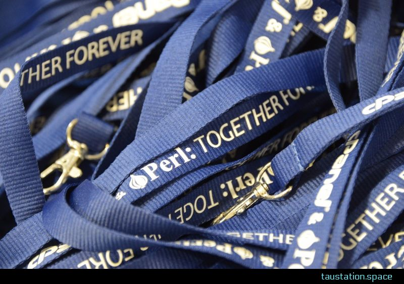 "A bunch of blue lanyards with the slogan ""Perl: Together Forever"""