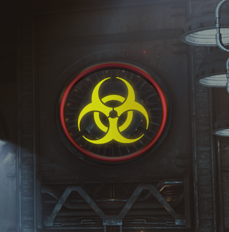 A big yellow bio-hazard symbol on a dark wall.