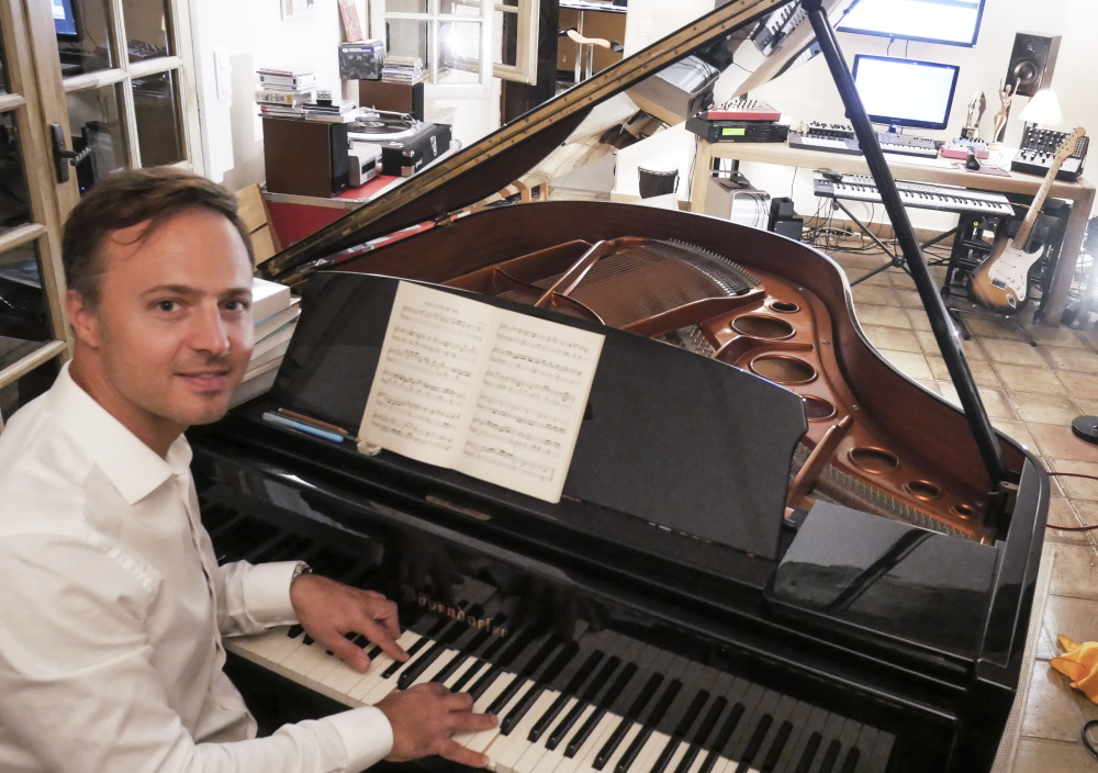 Luke Corradine in his studio, playing piano